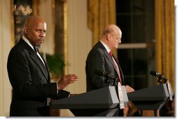 Actor Avery Brooks, (L), and Dr. Allen Guelzo make remarks during a ceremony in the East Room of the White House honoring Abraham Lincoln's 199th Birthday, Sunday, Feb. 10, 2008. White House photo by Chris Greenberg