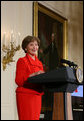 Mrs. Laura Bush welcomes guests to The Heart Truth reception Monday, Feb. 11, 2008, in the East Room of the White House, reminding women of the importance to protect their heart health. Mrs. Bush has served as the National Ambasasador for The Heart Truth national campaign since 2003. White House photo by Chris Greenberg