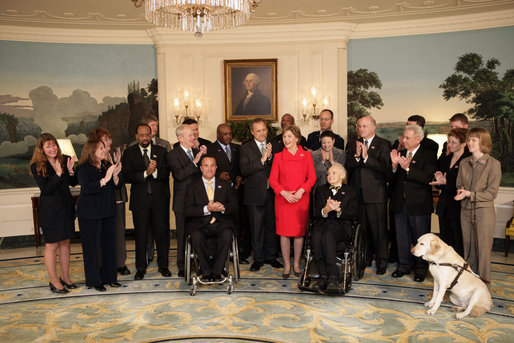 Mrs. Laura Bush participates in a photo opportunity with Jim Nussle, Director, Office of Management and Budget and employee of the year government workers from the AbilityOne 2007-2008 workforce Monday, Feb. 11, 2008, in the Diplomatic Room at the White House. White House photo by Shealah Craighead