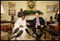 "President George W. Bush and Mali President Amadou Touré meet in the Oval Office Tuesday, Feb. 12, 2008, at the White House. Said President Bush upon welcoming his fellow leader, ""I was touched by the President's concern about the life of the average citizen in Mali. This is a country that's committed to the rights of its people, and we're proud to be standing side-by-side with you."" White House photo by Eric Draper"