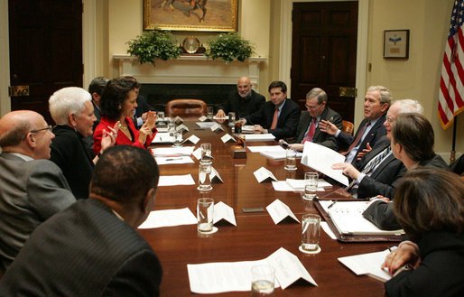 President George W. Bush attends the National Security Advisor's meeting with the Helping to Enhance the Livelihood of People around the Globe (H.E.L.P.) Commission Tuesday, Feb. 12, 2008, in the Roosevelt Room at the White House. The H.E.L.P. Commission reviews foreign assistance and provides recommendations to the President and Congress. White House photo by Joyce N. Boghosian