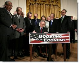 President George W. Bush signs H.R. 5140, the Economic Stimulus Act of 2008, Wednesday, Feb. 13, 2008, in the East Room at the White House.