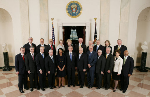 George W. Bush stands with members of his Cabinet in Cross Hall at ...