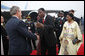 President George W. Bush is greeted by President Boni Yayi of Benin, and his wife, Madame Chantal de Souza Yayi, as he and Mrs. Laura Bush deplane Air Force One Saturday, Feb. 16, 2008, at the Cadjehoun International Airport in Cotonou, Benin. White House photo by Eric Draper