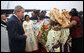 President George W. Bush is greeted by flower girls upon arrival Saturday, Feb. 6, 2008, at Cadjehoun International Airport in Cotonou, Benin, after he and Mrs. Laura Bush arrived at the first stop on their five-country, Africa visit. White House photo by Eric Draper