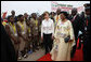 Mrs. Laura Bush and Madame Chantal de Souza Yayi, First Lady of Benin, walk the red carpet upon the arrival Saturday, Feb. 16, 2008, of Mrs. Bush and President George W. Bush to Benin. White House photo by Eric Draper