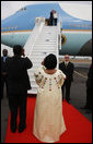 President George W. Bush and Mrs. Laura Bush wave to President Boni Yayi of Benin and Madame Chantal de Souza Yayi as they board Air Force One Saturday, Feb. 16, 2008, after visiting the African country on the first leg of their five-country trip. The President and Mrs. Bush later arrived in Tanzania, where they will spend two days. White House photo by Eric Draper