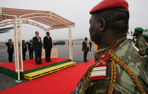 President George W. Bush and President Boni Yayi of Benin, stand for their respective national anthems Saturday, Feb. 16, 2008, after the President and Mrs. Laura Bush arrived at Cadjehoun International Airport in Cotonou, Benin, the first of five stops in Africa. White House photo by Chris Greenberg