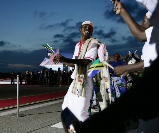 A participant in the welcoming ceremony for President George W. Bush and Mrs. Laura Bush dances near the red carpet at Julius Nyerere International Airport in Dar es Salaam as he rejoices in the arrival of U.S. leader to Tanzania. White House photo by Chris Greenberg