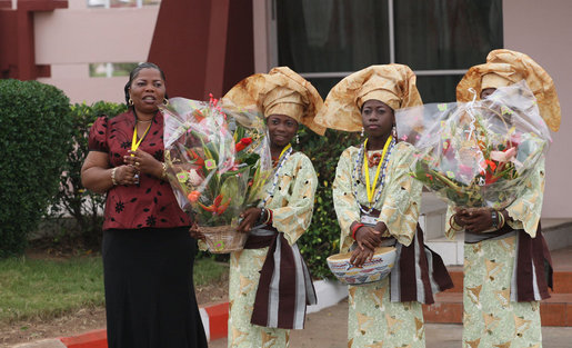 Flower girls await the arrival Saturday, Feb. 16, 2008, of President George W. Bush and Mrs. Laura Bush at Cadjehoun International Airport in Cotonou, Benin. The President and First Lady made the stop -- the first of their Africa visit – and spent the day before continuing on to Tanzania. White House photo by Shealah Craighead