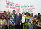 President George W. Bush and Mrs. Laura Bush pose with women at Cadjehoun International Airport in Cotonou, Benin Saturday, Feb. 16, 2008, after they greeted the President and First Lady upon arrival. White House photo by Shealah Craighead