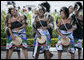 Young women in traditional costume dance during welcoming ceremonies for President George W. Bush and Mrs. Laura Bush Saturday, Feb. 16, 2008, at Julius Nyerere International Airport in Dar es Salaam, Tanzania. White House photo by Shealah Craighead