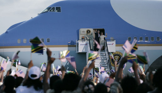 A sea of Tanzania and U.S. flags greets Air Force One as the aircraft carrying President George W. Bush and Mrs. Laura Bush arrives at Julius Nyerere International Airport Saturday, Feb. 16, 2008, in Dar es Salaam. White House photo by Shealah Craighead