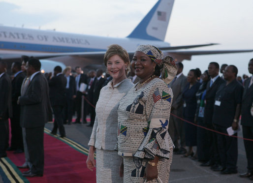 Mrs. Laura Bush and Salma Kikwete, wife of President Jakaya Kikwete of Tanzania, stand on the red carpet Saturday, Feb. 16, 2008, after the arrival of President George W. Bush and Mrs. Bush to Julius Nyerere International Airport in Dar es Salaam. White House photo by Shealah Craighead