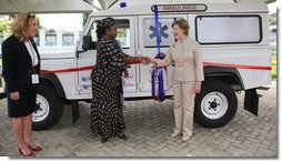 Mrs. Laura Bush and Mrs. Salma Kikwete, First Lady of Tanzania, exchange handshakes after Mrs. Bush presented Mrs. Kikwete with keys to an ambulance Sunday, Feb. 17, 2008, during her visit to Dar es Salaam. The ambulance will be donated to Sokoine Regional Hospital and will be used in the Lindi Region, one of the poorest and neediest in the country. The donation was a result of a joint visit to the hospital by Mrs. Kikwete and Pam White, left, USAID Mission Director. White House photo by Shealah Craighead