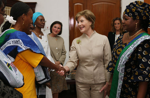 Mrs. Laura Bush is welcomed on her arrival to the WAMA Foundation Sunday, Fab. 17, 2008 in Dar es Salaam, Tanzania, for a meeting to launch the National Plan of Action for Orphans and Vulnerable Children. White House photo by Shealah Craighead