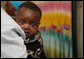 A young Tanzanian child is awed by the camera during a visit by Mrs. Laura Bush Sunday, Feb. 17, 2008, to the WAMA Foundation in Dar es Salaam. The foundation is a non-profit organization founded by Salma Kikwete, First Lady of Tanzania, with a focus on development by improving women's social and economic status by redefining gender roles and creating more opportunities for the development of women and children. White House photo by Shealah Craighead
