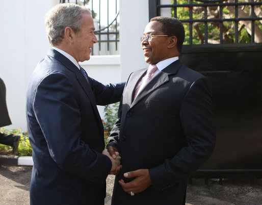 President George W. Bush is greeted by President Jakaya Kikwete of Tanzania, upon his arrival Sunday, Feb. 17, 2008, at the State House in Dar es Salaam. White House photo by Eric Draper