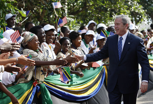 President George W. Bush reaches out to some of the hundreds of well-wishers in the ceremonial arrival cordon on hand to welcome him Sunday, Feb. 17, 2008, to the State House in Dar es Salaam, Tanzania. White House photo by Eric Draper