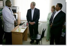 President George W. Bush and Mrs. Laura Bush, joined by Tanzanian President Jakaya Kikwete, visit with a staff doctor Sunday, Feb. 17, 2008, at the Amana District Hospital in Dar es Salaam, Tanzania, where President Bush and Mrs. Bush visited a patients and staff at the hospital's care and treament clinic. White House photo by Chris Greenberg