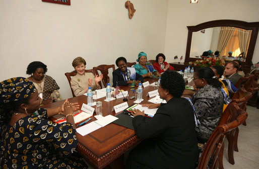 Mrs. Laura Bush participates in a roundtable discussion with faith-based HIV/AIDS Prevention Program graduates Sunday, Feb. 17, 2008, at Karimjee Hall in Dar es Salaam, Tanzania. Mrs. Bush reconfirmed America's commitment to the Tanzanian people and their continued efforts against HIV/AIDS. At left is Mrs. Salma Kikwete, First Lady of Tanzania. White House photo by Shealah Craighead