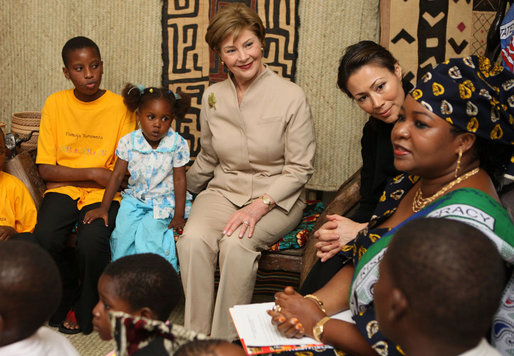 Mrs. Laura Bush joins a discussion with orphans and caretakers at the WAMA Foundation Sunday, Feb. 17, 2008 in Dar es Salaam, Tanzania, during a meeting to launch the National Plan of Action for Orphans and Vulnerable Children. White House photo by Shealah Craighead