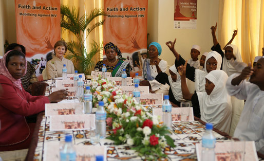 Mrs. Laura Bush and Mrs. Salma Kikwete sit at the head of the table during a roundtable Sunday, Feb. 17, 2008, in Dar es Salaam, with Madrasa graduates who have received HIV prevention education as part of their religious instruction. Madrasa training is comparable to the training students in the U.S. receive in Sunday school or Hebrew school. White House photo by Shealah Craighead