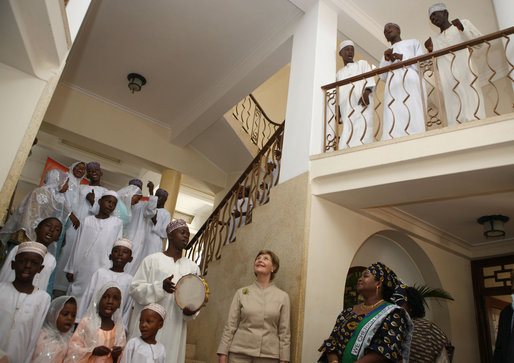 Mrs. Laura Bush and Mrs. Salma Kikwete acknowledge the performance of the Madrasa Salima Choir as they depart Karimjee Hall Sunday, Feb. 17, 2008, after participating in a roundtable discussion on HIV/AIDS. White House photo by Shealah Craighead
