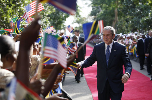 President George W. Bush shakes hands as he greets a large cheering crowd on his arrival Sunday, Feb. 17, 2008, to the State House in Dar es Salaam, Tanzania. White House photo by Eric Draper