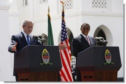 President George W. Bush delivers remarks as he participates in a joint press availability Sunday, Feb. 17, 2008, with President Jakaya Kikwete of Tanzania at the State House in Dar es Salaam. White House photo by Eric Draper