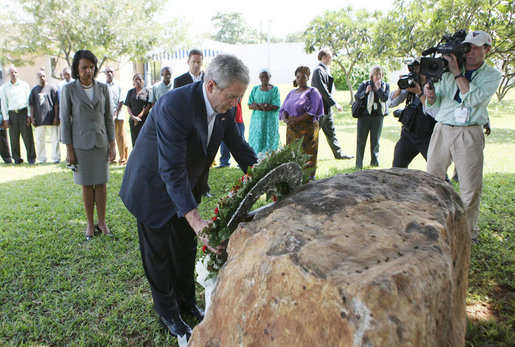 President George W. Bush lays a wreath Sunday, Feb. 17, 2008 in the memorial garden of the U.S. embassy in Dar es Salaam in Tanzania, during a memorial remembrance for those who died in the 1998 U.S. embassy bombing. U.S. Secretary of State Condoleezza Rice stands in background. White House photo by Eric Draper