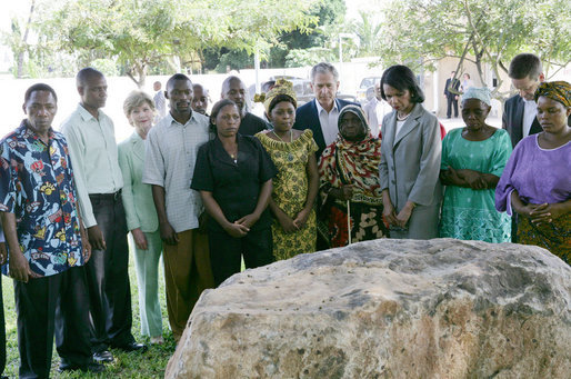 President George W. Bush and Mrs. Laura Bush, joined by U.S. Secretary of State Condoleezza Rice, stand with the family members of victims during a moment of silence Sunday, Feb. 17, 2008 in the memorial garden of the U.S. embassy in Dar es Salaam in Tanzania, in remembrance for those who died in the 1998 U.S. embassy bombing. White House photo by Chris Greenberg