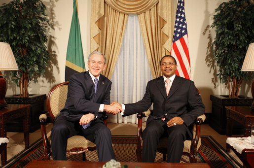 President George W. Bush and President Jakaya Kikwete of Tanzania shake hands before the start of their meeting Sunday, Feb. 17, 2008, at the State House in Dar es Salaam. White House photo by Eric Draper