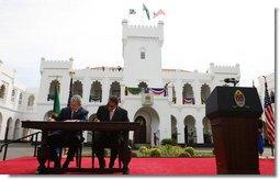 President George W. Bush and President Jakaya Kikwete of Tanzania, sign the Millennium Challenge Compact -- a $698 million dollar compact that is the largest project in the Millennium Challenge Corporation's history – prior to the start of their joint press availability Sunday, Feb. 17, 2008, at the State House in Dar es Salaam. White House photo by Eric Draper