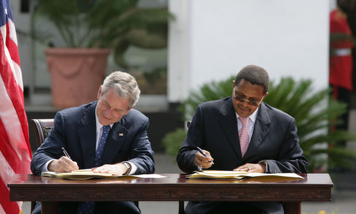 President George W. Bush and President Jakaya Kilwete of Tanzania sign the Millenium Challenge Compact Sunday, Feb. 17, 2008, at the State House in Dar es Salaam, Tanzania. White House photo by Chris Greenberg