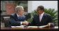 "President George W. Bush and President Jakaya Kikwete of Tanzania, shake hands after signing the $698 million Millennium Challenge Compact Sunday, Feb. 17, 2008, in Dar es Salaam. In signing the compact, President Bush said, ""We are partners in democracy. We believe that governments ought to respond to the people. We're also partners in fighting disease, extending opportunity and working for peace. Mr. President, I mentioned I was proud to sign, along with the President, the largest Millennium Challenge Account in the history of the United States here in Tanzania. It will provide nearly $700 million over five years to improve Tanzania's transportation network, secure reliable supplies of energy, and expand access to clean and safe water."" White House photo by Chris Greenberg"
