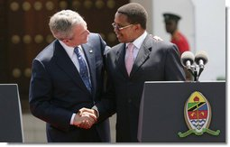 President George W. Bush and President Jakaya Kilwete of Tanzania shake hands following their joint press availability Sunday, Feb. 17, 2008, at the State House in Dar es Salaam, Tanzania. White House photo by Chris Greenberg