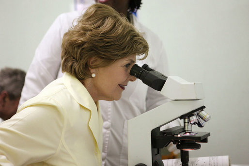Mrs. Laura Bush views a medical slide thru a microscope Monday, Feb. 18, 2008, during a tour of the Meru District Hospital outpatient clinic in Arusha, Tanzania. White House photo by Eric Draper