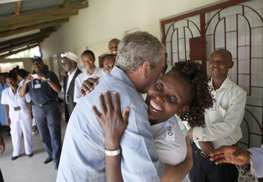 President George W. Bush embraces a hospital staff member Monday, Feb. 18, 2008, during a tour of the outpatient facility at the Meru District Hospital in Arusha, Tanzania. White House photo by Eric Draper