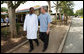President George W. Bush walks with Dr. Aziz Msuya Monday, Feb. 18, 2008, during a tour of the Meru District Hospital outpatient clinic in Arusha, Tanzania. White House photo by Eric Draper