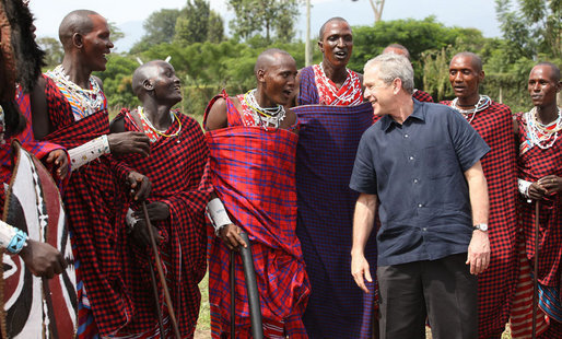 President George W. Bush joins members of a Maasai warrior dance group during their performance to welcome President Bush and Mrs. Laura Bush Monday, Feb. 18, 2008, to the Maasai Girls School in Arusha, Tanzania. White House photo by Eric Draper