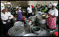 Women work serving dishes of fish, rice and beans at the fish market, Monday, February 18, 2008 in the Tanzanian capitol of Dar es Salaam. White House photo by Chris Greenberg
