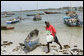 Fishing boats sit at the ready on the beach adjacent to the fish market, Monday, February 18, 2008 in the Tanzanian capitol of Dar es Salaam. White House photo by Chris Greenberg