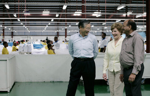 Mrs. Laura Bush speaks with the management representatives of A to Z Textiles Monday, Feb. 18, 2008, in Arusha, Tanzania, where workers stitch mosquito nets in the fight against malaria. White House photo by Shealah Craighead