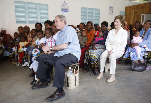 President George W. Bush and Mrs. Laura Bush join children and their families in the pediatric outpatient clinic Monday, Feb. 18, 2008, at the Meru District Hospital in Arusha, Tanzania. White House photo by Eric Draper