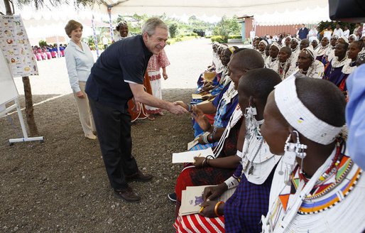 President George W. Bush, joined by Mrs. Laura Bush, greets guests, students and their families during a welcome program Monday, Feb. 18, 2008, to the Maasai Girls School in Arusha, Tanzania. White House photo by Eric Draper