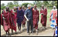 President George W. Bush thanks a Maasai warrior dance group for their performance in welcoming President Bush and Mrs. Laura Bush Monday, Feb. 18, 2008, to the Maasai Girls School in Arusha, Tanzania. White House photo by Eric Draper