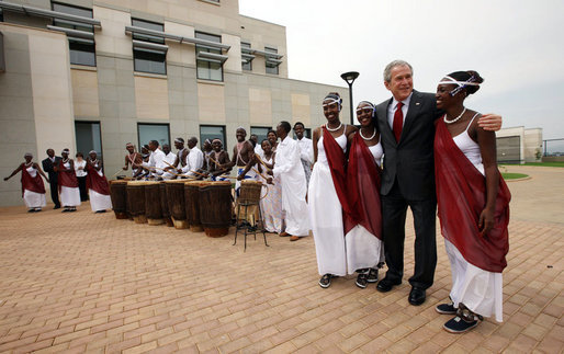 President George W. Bush greets cultural dancers during his visit Tuesday, Feb. 19, 2008, to the dedication and official opening of the new U.S. Embassy in Kigali, Rwanda. White House photo by Eric Draper