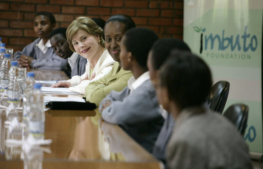 Mrs. Laura Bush joins Rwanda first lady Jeannette Kagame, center, as they listen to students during a forum Tuesday, Feb. 19, 2008 in Kigali, Rwanda, to promote girl's education. White House photo by Shealah Craighead