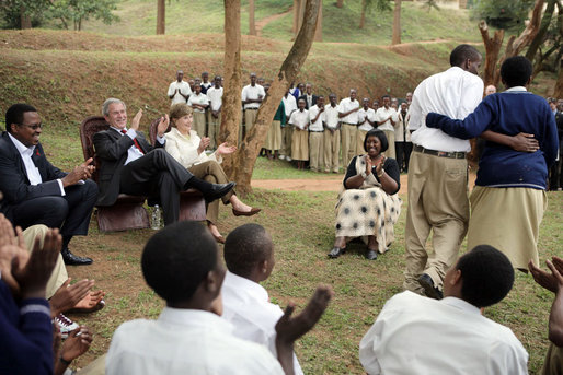 President George W. Bush and Mrs. Laura Bush applaud after a theatrical performance by members of the Lycee de Kigali 'Anti-AIDS Club' Tuesday Feb. 19, 2008, outside of the Lycee de Kigali in Kigali, Rwanda. White House photo by Shealah Craighead